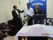 Dr. Celeste Hicks and I praying for Pastor Deva Dhas from India